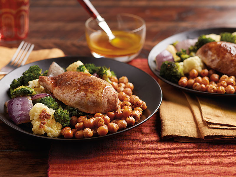 Two servings of Garam Masala chicken with a side of garbanzo beans and vegetables